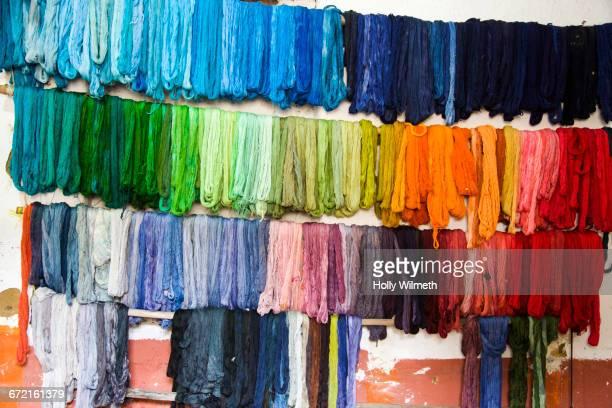 dyed fabric hanging on wall - färbemittel stock-fotos und bilder