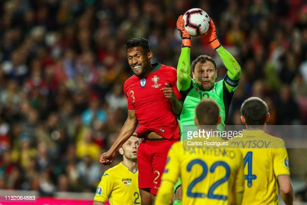 Dyego Sousa of Portugal and SC Braga vies with Andriy Pyatov of Ukraine for the ball possession during the 2020 UEFA European Championships...