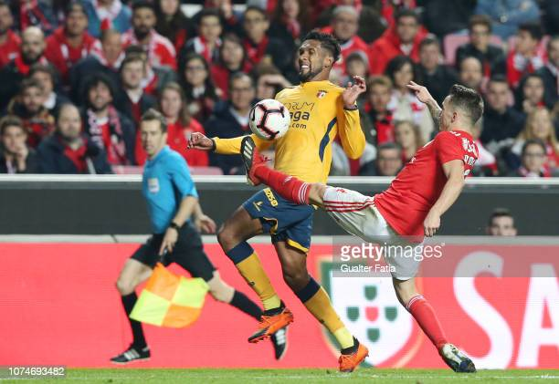 Dyego Souza of SC Braga with Alex Grimaldo of SL Benfica in action during the Liga NOS match between SL Benfica and SC Braga at Estadio da Luz on...