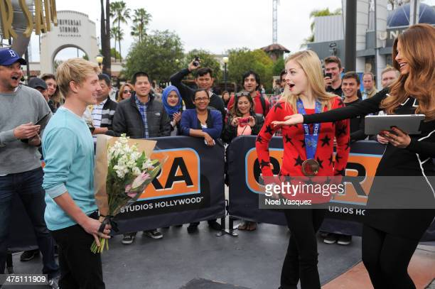 Dyer Pettijohn surprises Gracie Gold at 'Extra' at Universal Studios Hollywood on February 26 2014 in Universal City California