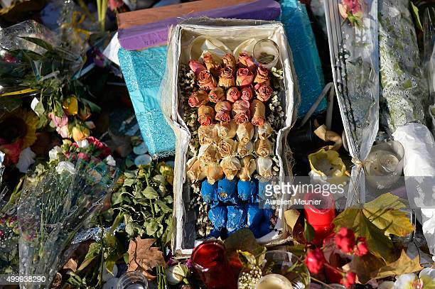 Dying roses can be seen in front of the Bataclan as people continue to leave tributes to victims at attack sites in Paris on December 4, 2015 in...