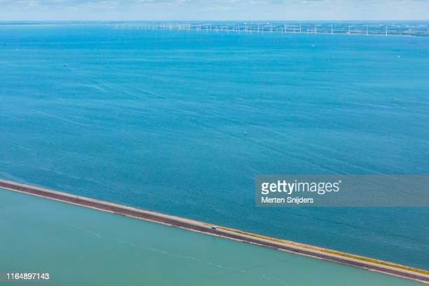 dyke dividing the markermeer and ijsselmeer - merten snijders stock pictures, royalty-free photos & images