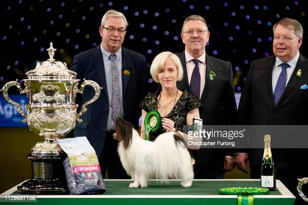 Dylan, a Papillon from Belgium, and owner Kathleen Roosens pose with trophy after winning Best in Show on the last day of Crufts Dog Show at the...