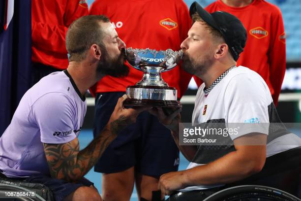 Dylan Alcott and Heath Davidson of Australia kiss the cup after winning their Quad Wheelchair Doubles Final match against Andy Lapthorne of Great...
