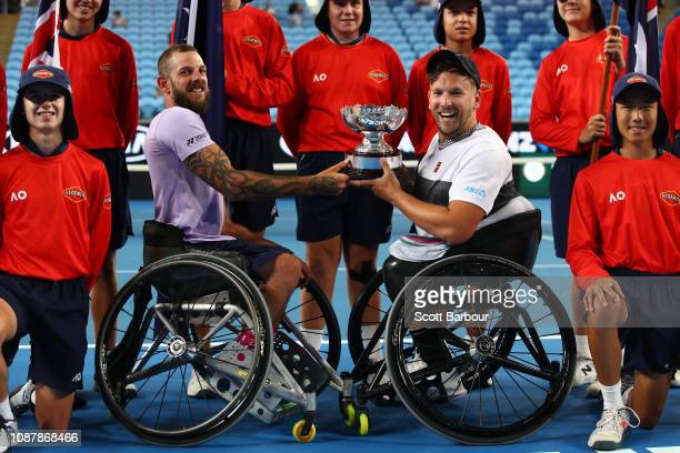 Dylan Alcott and Heath Davidson of Australia pose with the cup after winning their Quad Wheelchair Doubles Final match against Andy Lapthorne of...