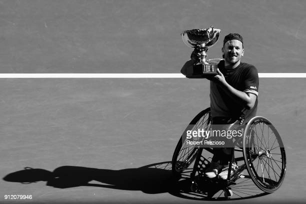 Dylan Alcott holds aloft the winners trophy in his final match at Melbourne Park on January 27 2018 in Melbourne Australia Alcott dominated the 2018...