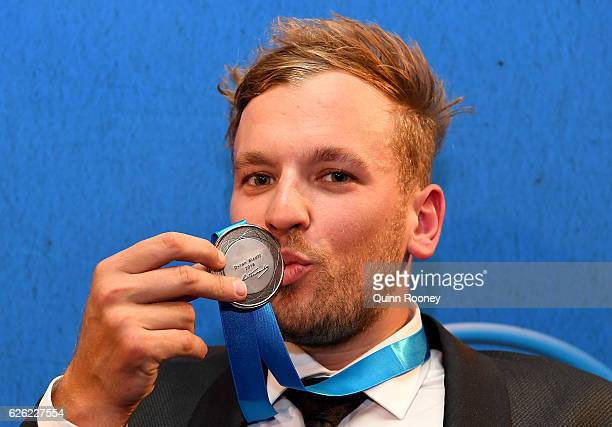Dylan Alcott kisses the medal after he won the Newcombe Medal at the 2016 Newcombe Medal at Crown Palladium on November 28 2016 in Melbourne Australia