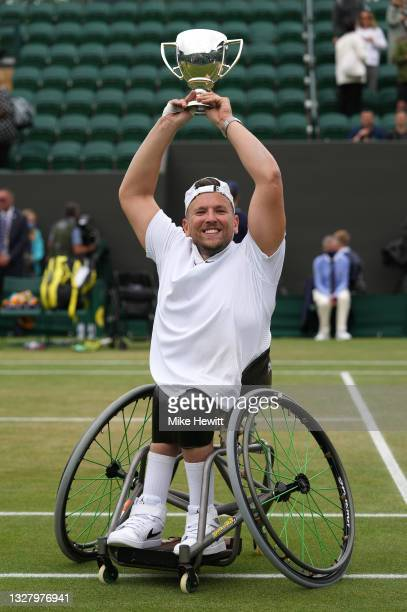 Dylan Alcott of Australia celebrates with the trophy after winning his Quad Wheelchair Singles Final match against Sam Schroder of Netherlands on Day...