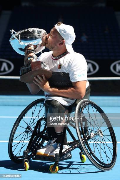 Dylan Alcott of Australia kisses the championship trophy following victory his Quad Wheelchair Singles Final match against David Wagner of the United...