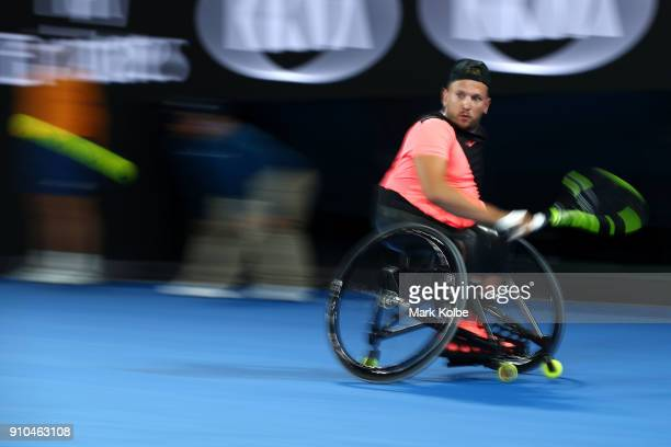 Dylan Alcott of Australia plays a backhand during the Australian Open 2018 Wheelchair Championships at Melbourne Park on January 26 2018 in Melbourne...