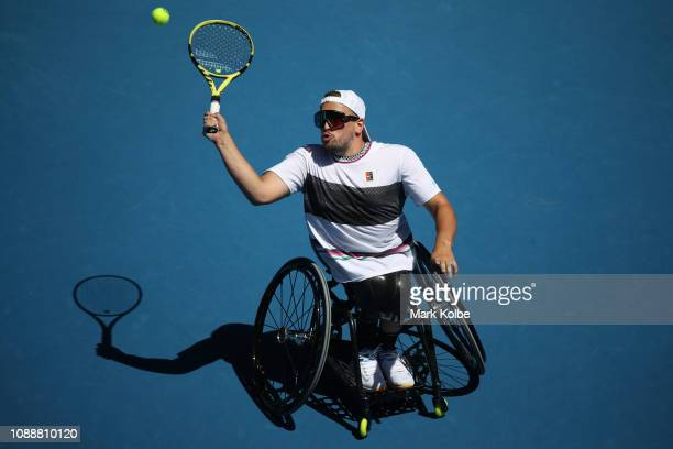 Dylan Alcott of Australia plays a forehand in his Quad Wheelchair Singles Final match against David Wagner of the United States during day 13 of the...