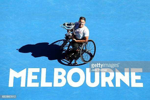 Dylan Alcott of Australia poses with the championship trophy after winning his Quad Wheelchair Singles Final against Andy Lapthorne of Great Britain...