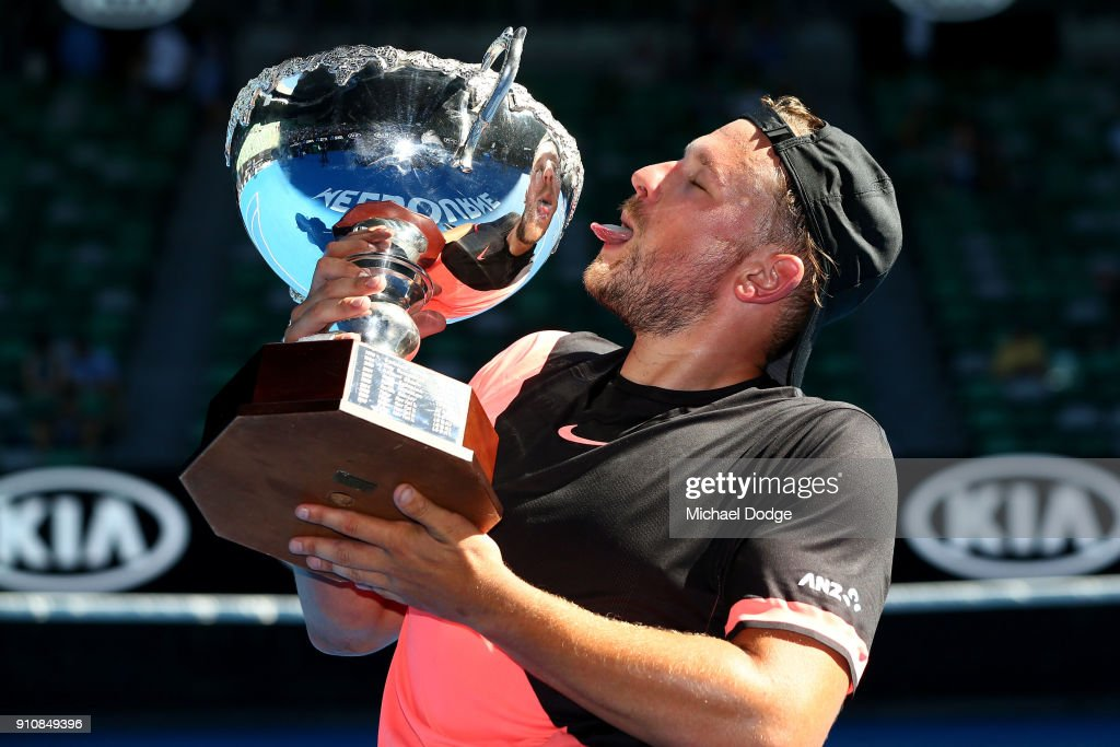 Dylan Alcott of Australia poses with the championship trophy after winning the Quad Wheelchair Singles Final against David Wagner of the United States during the Australian Open 2018 Wheelchair Championships at Melbourne Park on January 27, 2018 in Melbourne, Australia.