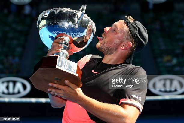 Dylan Alcott of Australia poses with the championship trophy after winning the Quad Wheelchair Singles Final against David Wagner of the United...