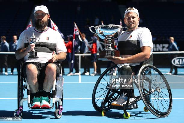 Dylan Alcott of Australia poses with the championship trophy and David Wagner of the United States poses with the runners up trophy following their...