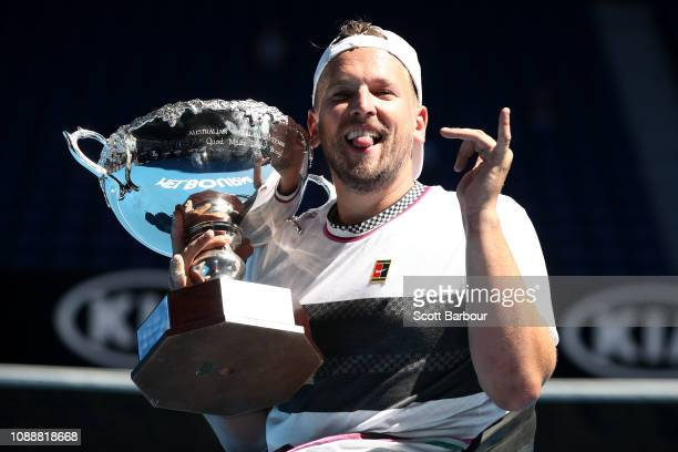 Dylan Alcott of Australia poses with the championship trophy following victory his Quad Wheelchair Singles Final match against David Wagner of the...