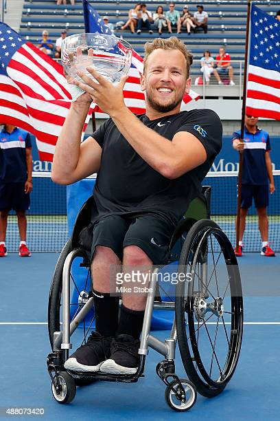 Dylan Alcott of Australia poses with trophy after defeating David Wagner of the United States in their Men's Wheelchair Quad Singles Final on Day...