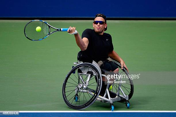 Dylan Alcott of Australia returns a shot to David Wagner of the United States during their Wheelchair Quad Singleson Day Fourteen of the 2015 US Open...