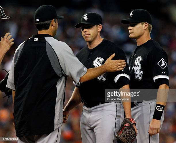 Dylan Axelrod of the Chicago White Sox is pulled from the game by manager manager Robin Ventura left as Gordon Beckham looks on in the sixth inning...
