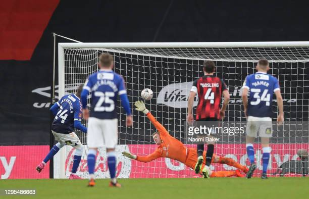 Dylan Bahamboula of Oldham Athletic scores his team's first goal from the penalty spot during the FA Cup Third Round match between Oldham Athletic...