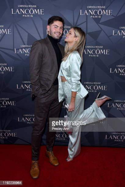 Dylan Barbour and Hannah Godwin attend Lancôme x Vogue L'Absolu Ruby Holiday Event at Raspoutine on December 05 2019 in West Hollywood California