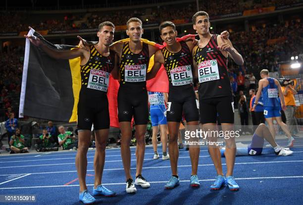 Dylan Borlee Jonathan Borlee Kevin Borlee and Jonathan Sacoor of Belgium celebrate winning the gold medal in the Men's 4 x 400m Relay during day five...