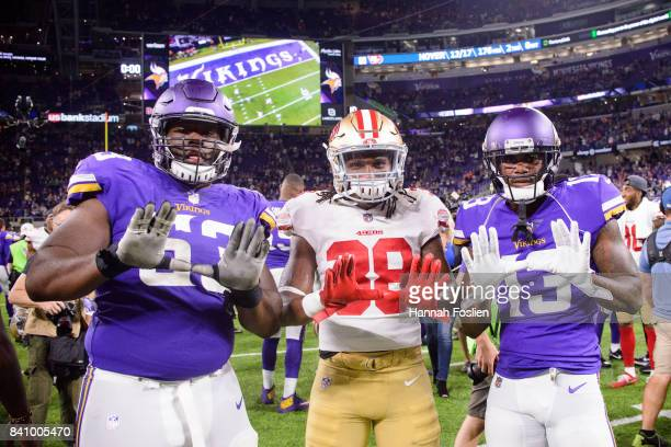 Dylan Bradley and Stacy Coley of the Minnesota Vikings pose for a photo with Adrian Colbert of the San Francisco 49ers after the preseason game on...