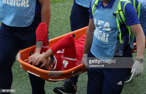 Dylan Bronn of Tunisia is carried off the pitch on a stretcher before being substituted during the 2018 FIFA World Cup Russia group G match between...
