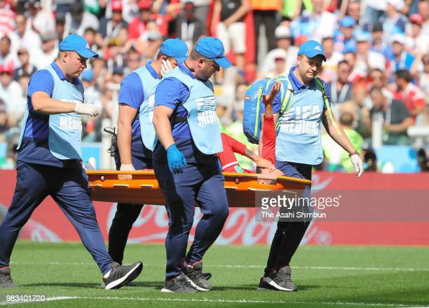 Dylan Bronn of Tunisia is taken off by a stretcher after picking up an injury during the 2018 FIFA World Cup Russia group G match between Belgium and...