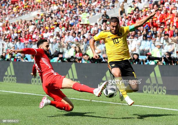 Dylan Bronn of Tunisia tackles Eden Hazard of Belgium during the 2018 FIFA World Cup Russia group G match between Belgium and Tunisia at Spartak...