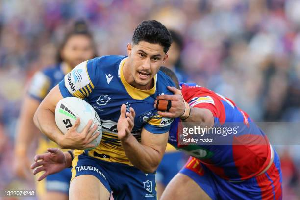 Dylan Brown of the Eels is tackled during the round 13 NRL match between the Newcastle Knights and the Parramatta Eels at McDonald Jones Stadium, on...