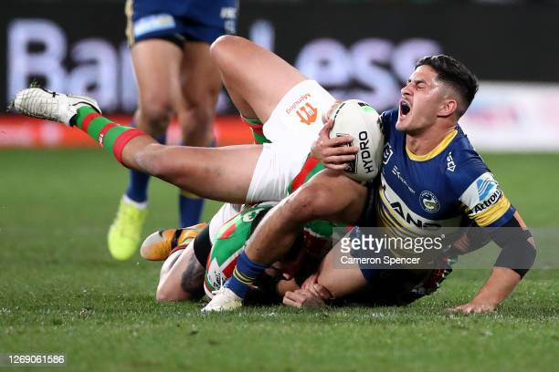 Dylan Brown of the Eels is tackled during the round 16 NRL match between the Parramatta Eels and the South Sydney Rabbitohs at Bankwest Stadium on...