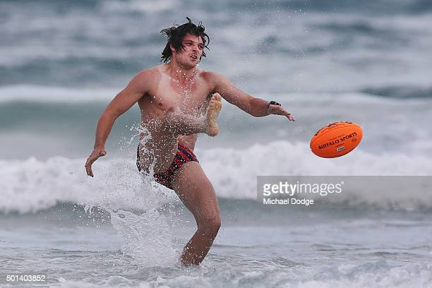 Dylan Buckley kicks the ball while participating in a recovery session a the beach during the Carlton Blues AFL preseason training camp on December...