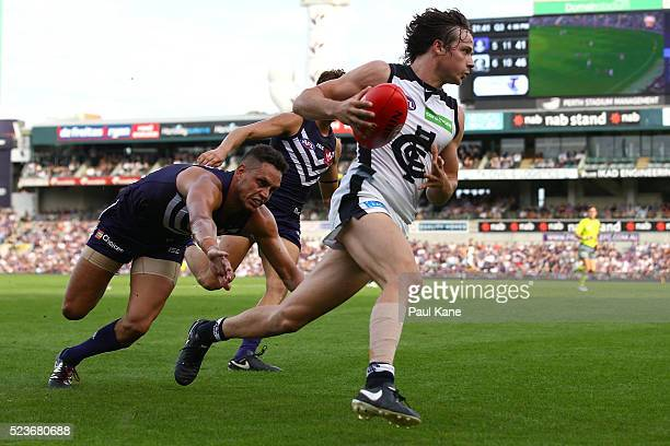 Dylan Buckley of the Blues looks to break from a tackle by Michael Johnson of the Dockers during the round five AFL match between the Fremantle...