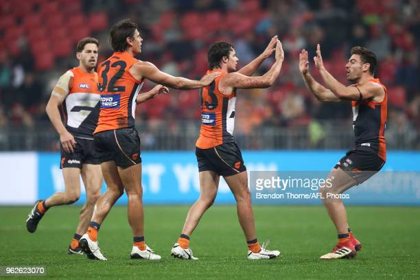 Dylan Buckley of the Giants celebrates kicking a goal with team mates during the round 10 AFL match between the Greater Western Sydney Giants and the...