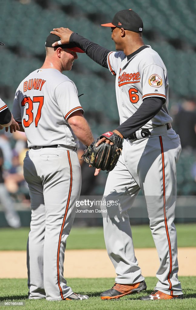 Dylan Bundy #37 of the Baltimore Orioles gets a pat on the head from Jonathan Schoop #6 after pitching for a complete game win against the Chicago White Sox at Guaranteed Rate Field on May 24, 2018 in Chicago, Illinois. The Orioles defeated the White Sox 9-3.