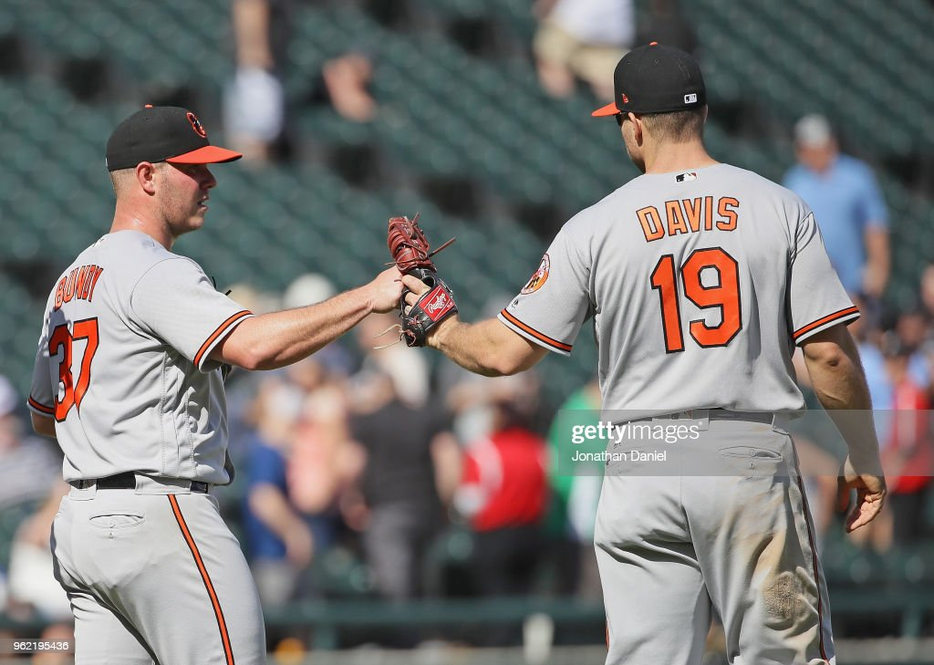 Dylan Bundy #37 of the Baltimore Orioles is congratulated by Chris Davis #19 after pitching for a complete game win against the Chicago White Sox at Guaranteed Rate Field on May 24, 2018 in Chicago, Illinois. The Orioles defeated the White Sox 9-3.