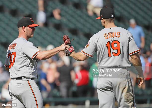 Dylan Bundy of the Baltimore Orioles is congratulated by Chris Davis after pitching for a complete game win against the Chicago White Sox at...