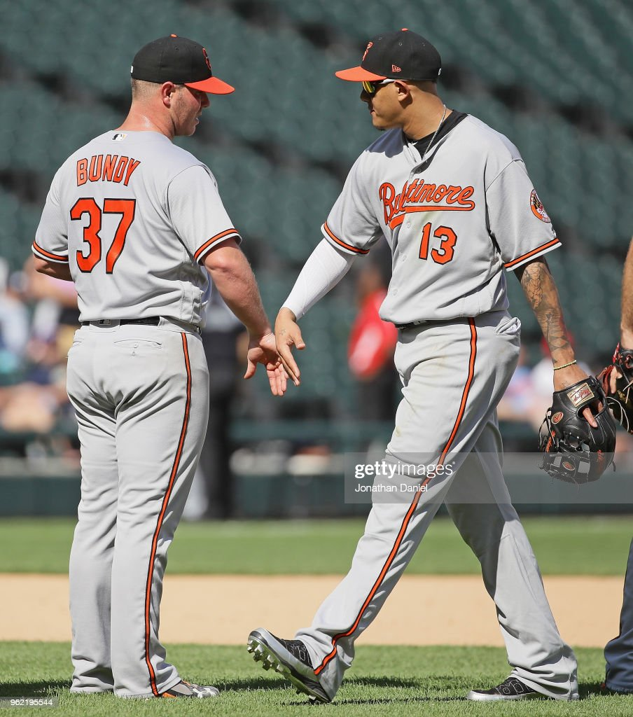 Dylan Bundy #37 of the Baltimore Orioles is congratulated by Manny Machado #13 after pitching for a complete game win against the Chicago White Sox at Guaranteed Rate Field on May 24, 2018 in Chicago, Illinois. The Orioles defeated the White Sox 9-3.