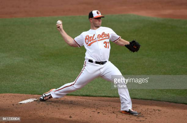 Dylan Bundy of the Baltimore Orioles pitches against the Minnesota Twins on Opening Day at Oriole Park at Camden Yards on March 29 2018 in Baltimore...