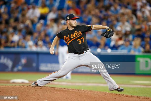 Dylan Bundy of the Baltimore Orioles pitches to the Toronto Blue Jays in the first inning during their MLB game at the Rogers Centre on July 5 2019...