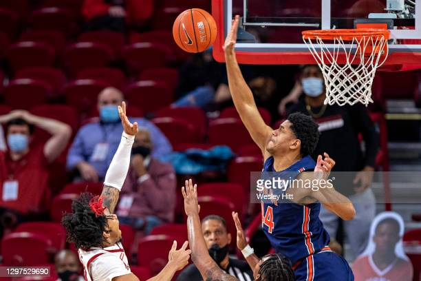 Dylan Cardwell of the Auburn Tigers blocks a shot in the second half by Desi Sills of the Arkansas Razorbacks at Bud Walton Arena on January 20, 2021...