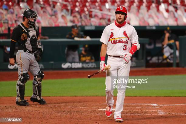 Dylan Carlson of the St. Louis Cardinals returns to the dugout after striking out against the Pittsburgh Pirates in the seventh inning during game...