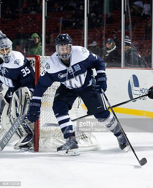 """Dylan Chanter of the New Hampshire Wildcats skates against the Northeastern Huskies during NCAA hockey at Fenway Park during """"Frozen Fenway"""" on..."""