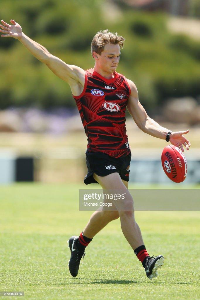 Dylan Clarke of Essendon kicks the ball during an Essendon Bombers AFL training session at the Essendon Football Club on November 13, 2017 in Melbourne, Australia.