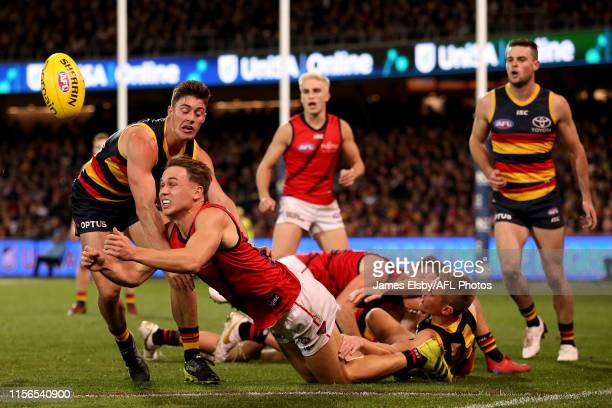 Dylan Clarke of the Bombers is tackled by Riley Knight of the Crows during the 2019 AFL round 18 match between the Adelaide Crows and the Essendon...