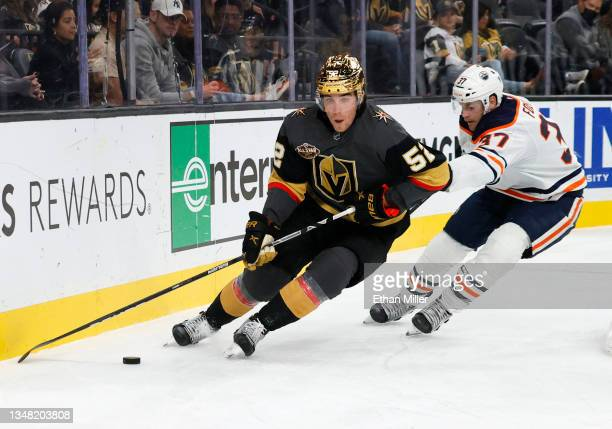 Dylan Coghlan of the Vegas Golden Knights skates with the puck against Warren Foegele of the Edmonton Oilers in the third period of their game at...