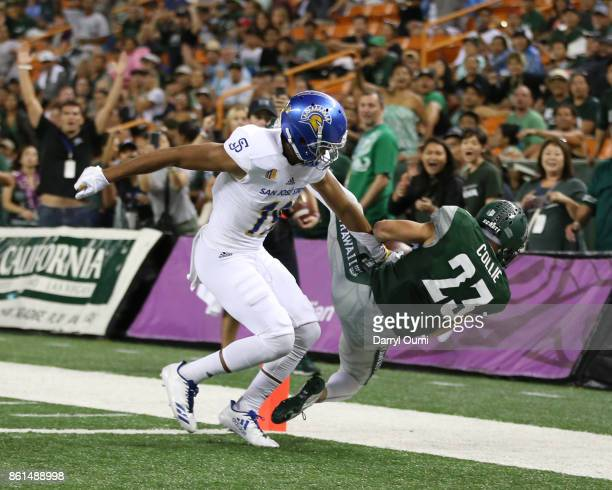 Dylan Collie of the Hawaii Rainbow Warriors comes down with the ball and manages to stay inbounds to score a touchdown during the third quarter of...