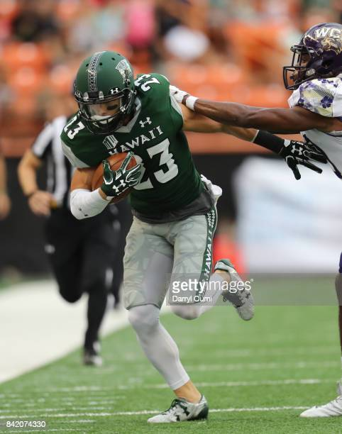 Dylan Collie of the Hawaii Rainbow Warriors is shoved out of bounds in the first quarter of the game against the Western Carolina Catamounts at Aloha...