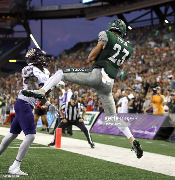 Dylan Collie of the Hawaii Rainbow Warriors rises up and makes the catch to score a touchdown in the second quarter of the game against the Western...